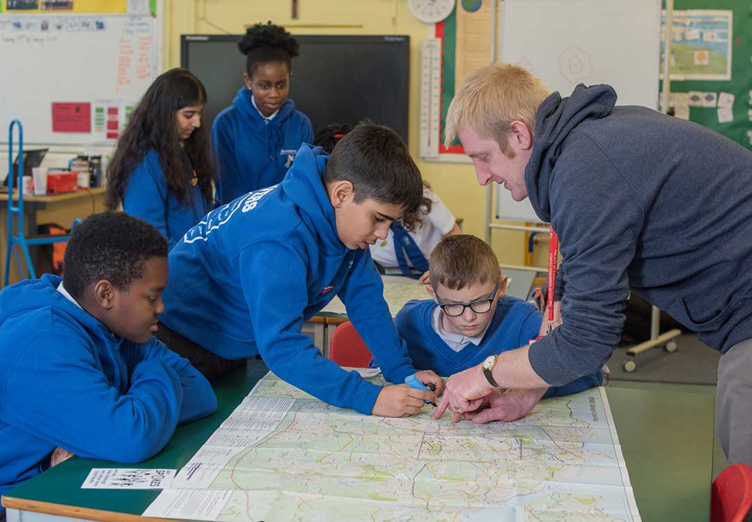 I Bike officer and pupils planning a journey using a map