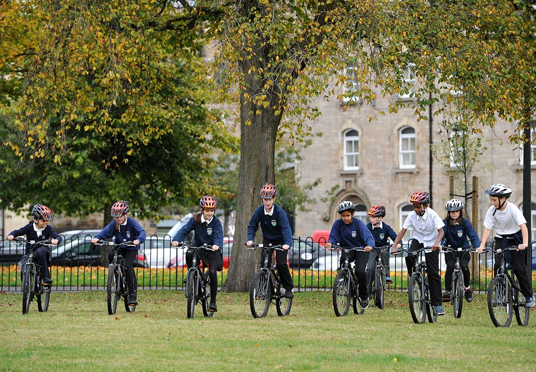 Pupils riding in a park
