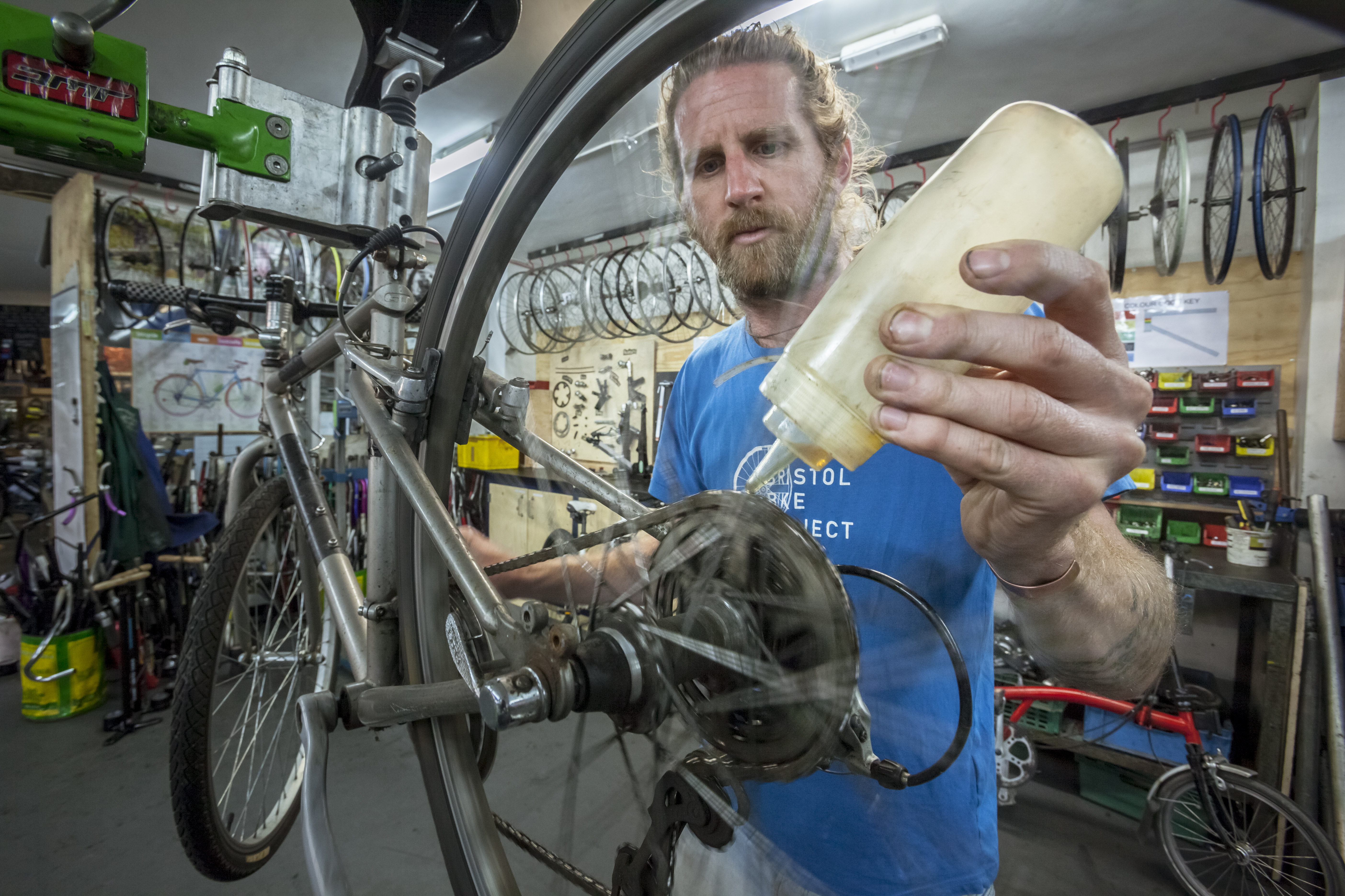 James Lucas - founder of the Bristol Bike Project repairing a bike