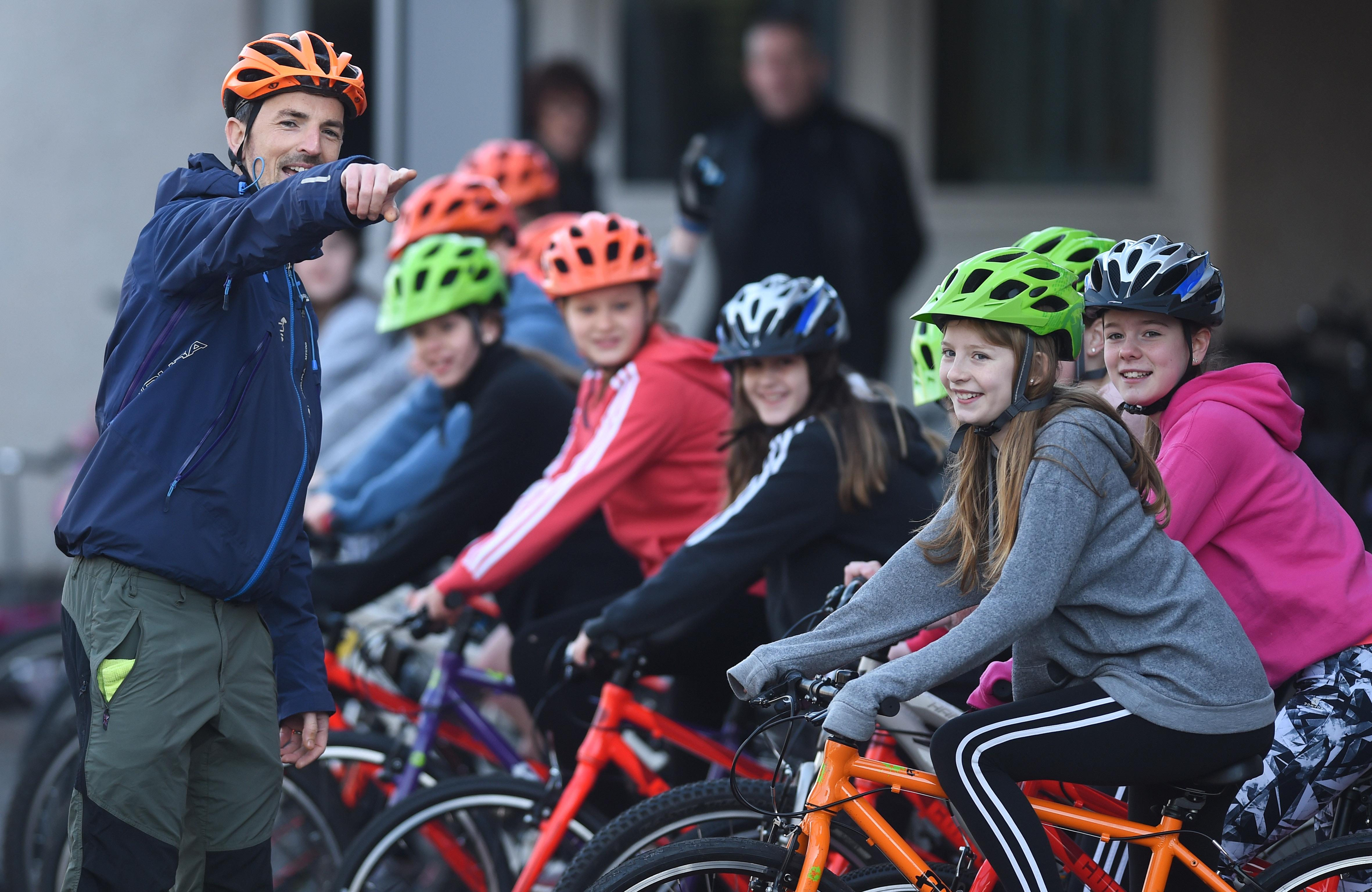 Pupils and I Bike officer enjoying cycling skills lesson