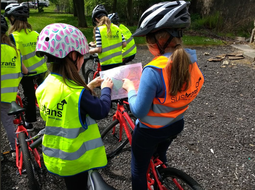 West Lothian pupils paired up working where to go next on an orienteering trip