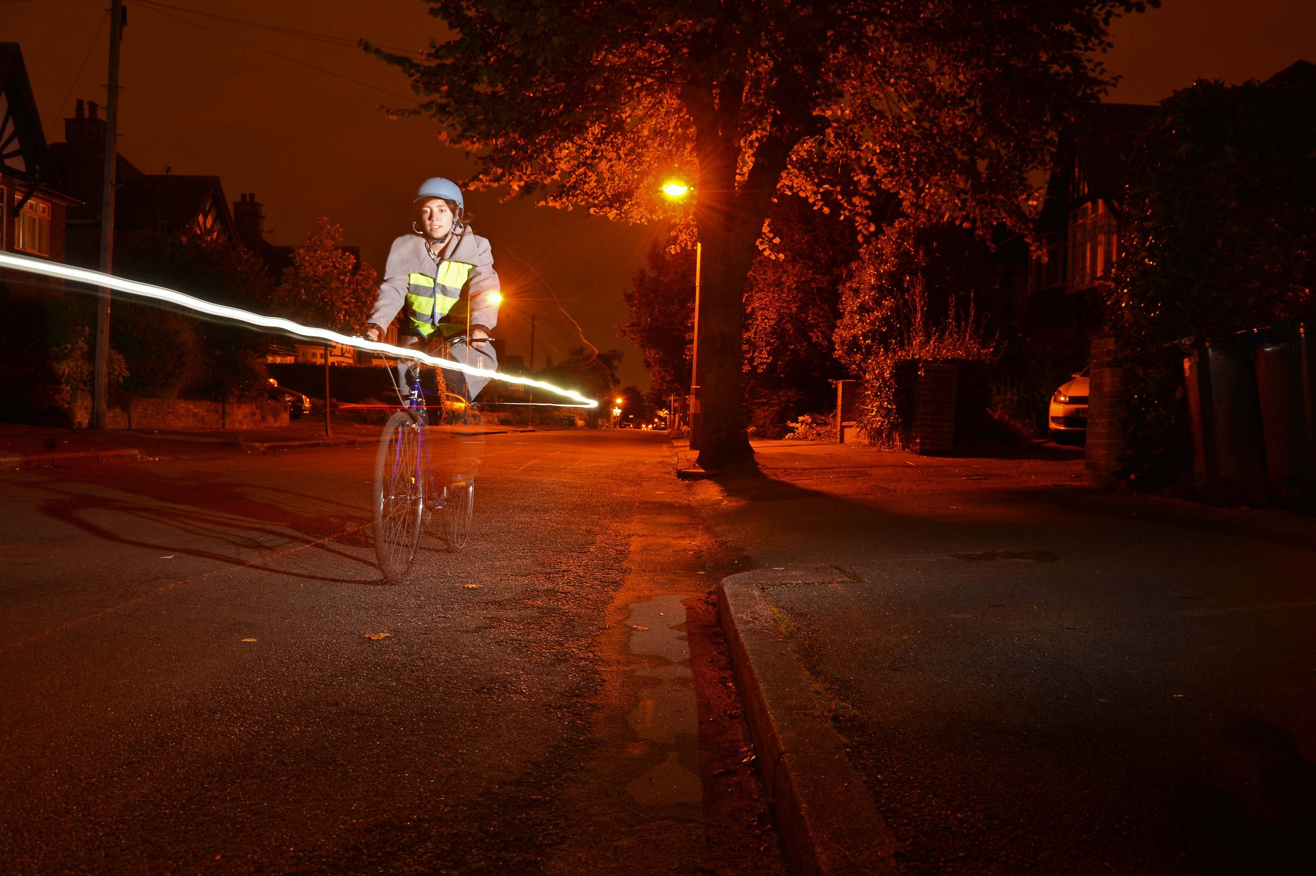 Cycling rideing with lights & Reflective clothing to help them be seen when it's dark